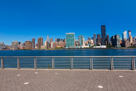 Manhattan New York sunny skyline East River sunshine NYC USA photo