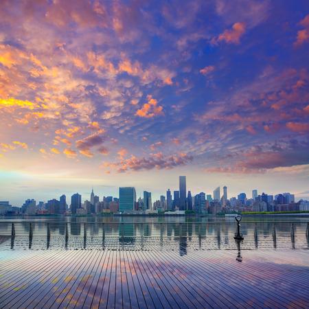 Manhattan New York skyline at sunset from East River dusk USA Stock Photo