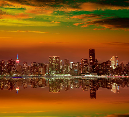 Manhattan New York skyline at sunset dusk from East River NYC USA photo