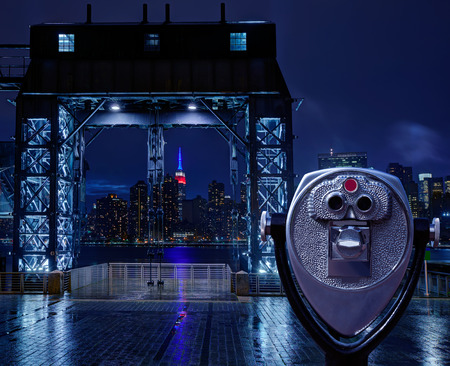 floodgates: Manhattan New York skyline rainy night East River floodgates and telescope photomount