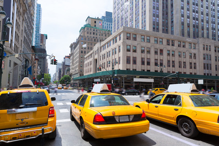 new automobiles: New York city Manhattan Fifth Avenue 5th Av yellow taxi cab US Stock Photo