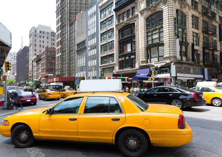 new york buildings: New York city Manhattan Fifth Avenue 5th Av yellow taxi cab US Stock Photo