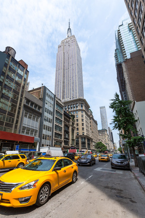 taxi famous building: New York city Manhattan Fifth Avenue 5th Av yellow taxi cab US Stock Photo