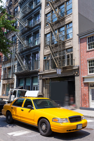 taxi famous building: New York Soho buildings yellow cab taxi of Manhattan New York City NYC USA