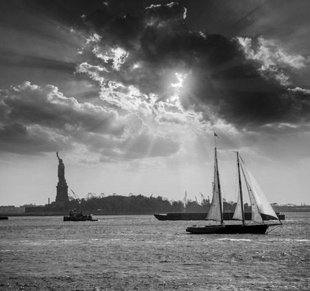 New York sailboat sunset and Statue of Liberty from Manhattan US photo
