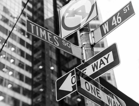 Times Square signs & W 46 st New York daylight US