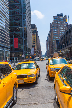 taxi famous building: Times Square New York yellow cab taxi daylight US