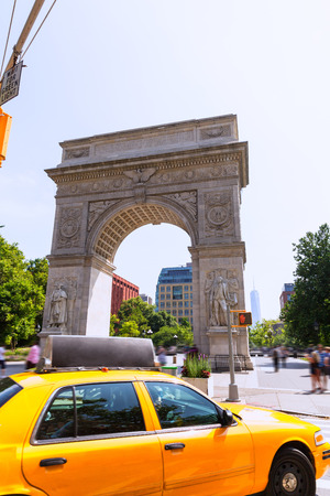 taxi famous building: Manhattan Washington Square Park Arch and yellow cab in New York City USA Stock Photo