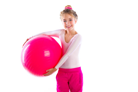 swiss ball: blond fitness kid girls exercise workout with swiss ball fitball on white