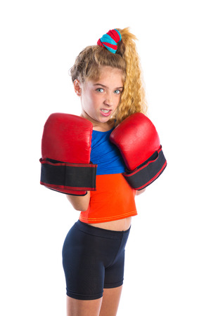 kidding: boxer kid blond girl with funny boxing gloves kidding aggressive gesture expression