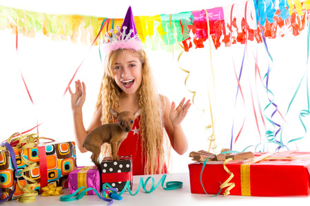 Party blond kid girl happy with puppy present Chihuahua doggy photo