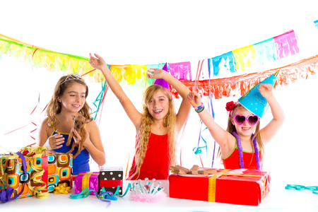 funny birthday: girl friends party dancing with presents and puppy chihuahua dog in birthday