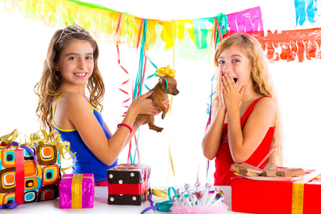 girl friends party excited with puppy chihuahua present dog in birthday photo