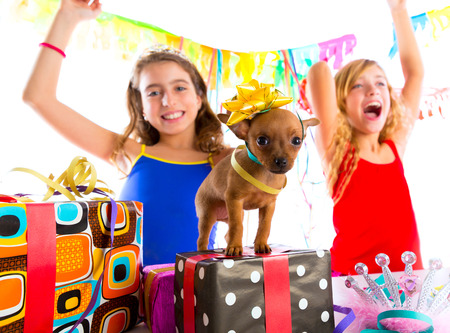 girl friends party dancing with presents and puppy chihuahua dog in birthday photo