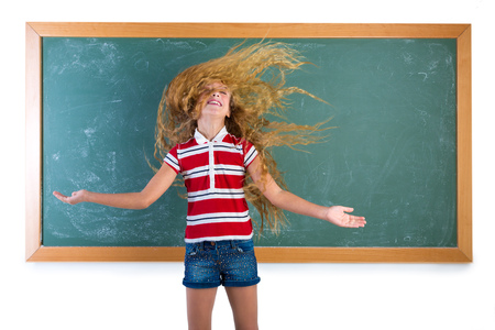 crazy hair: funny student girl flipping long blond hair at school classroom chalk board