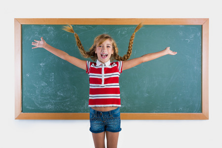 blue jeans kids: Braided student blond girl playing in green chalkboard with braids at school classroom