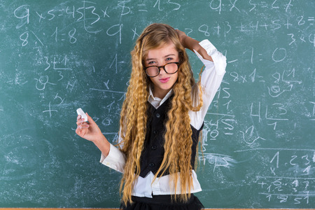 Clever nerd pupil blond girl in green board student difficult expression schoolgirl Stock Photo