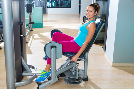 abduction: Hip abduction woman exercise at gym indoor opening legs workout Stock Photo