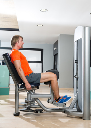 abduction: Hip abduction blond man exercise at gym indoor closing legs workout