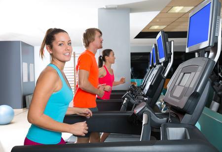 Gym treadmill group running indoor women and blond man photo