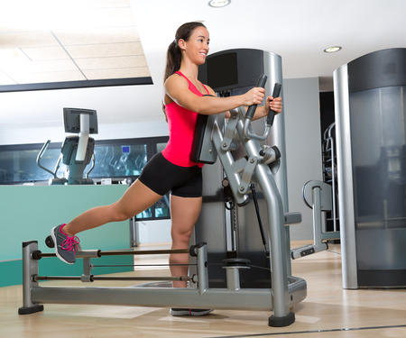 exercise machine: Gym glute exercise machine woman workout indoor Stock Photo
