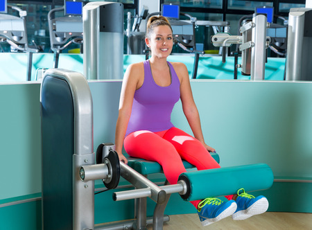 extension: Gym leg extension exercise workout woman indoor Stock Photo