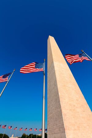 district of columbia: Washington Monument and american flags in District of Columbia DC USA Editorial