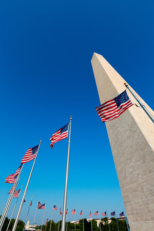 columbia district: Washington Monument and american flags in District of Columbia DC USA Editorial