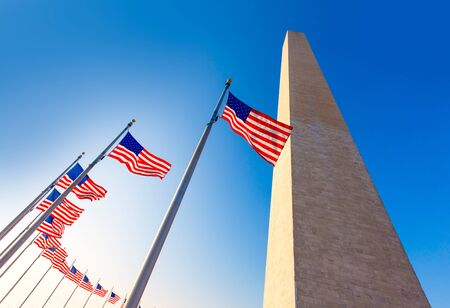 usa patriotic: Washington Monument and american flags in District of Columbia DC USA Editorial