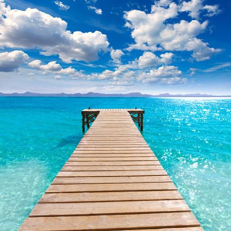 Platja de Alcudia beach pier in Mallorca Majorca at Balearic islands of Spain
