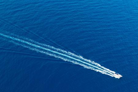 speed boat: Boat surf foam aerial from prop wash in blue Majorca mediterranean sea