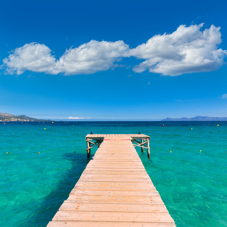 majorca: Majorca Platja de Muro beach pier in Alcudia bay in Mallorca Balearic islands of Spain