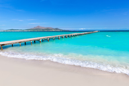 Majorca Platja de Muro beach pier in Alcudia bay in Mallorca Balearic islands of Spain