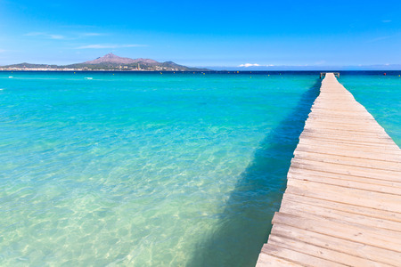 balearic: Majorca Platja de Muro beach pier in Alcudia bay in Mallorca Balearic islands of Spain