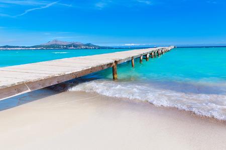 baleares: Majorca Platja de Muro beach pier in Alcudia bay in Mallorca Balearic islands of Spain