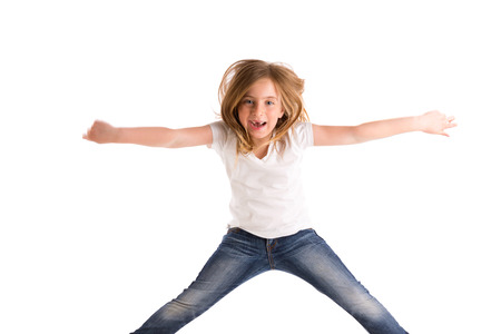 blue jeans kids: blond kid girl indented jumping high wind on hair denim jeans at white background