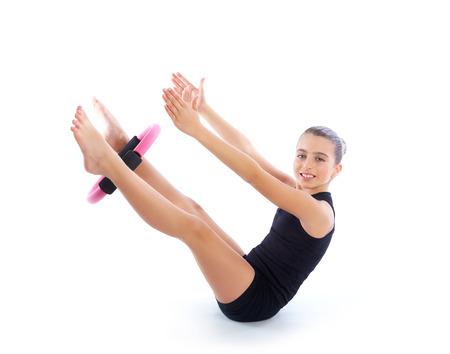 limber: Fitness pilates yoga ring kid girl exercise workout on white  Stock Photo