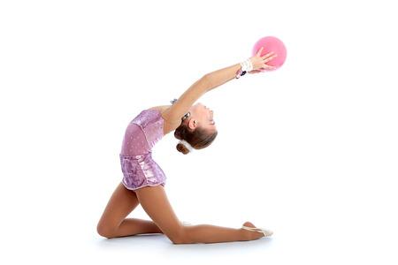 calisthenics: Kid girl ball rhythmic gymnastics exercise on white  Stock Photo