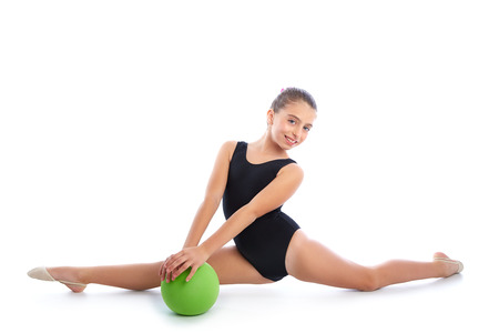 young gymnast: Kid girl ball rhythmic gymnastics exercise on white  Stock Photo