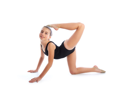 female gymnast: Kid girl rhythmic gymnastics exercises on white background