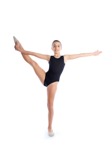 young gymnast: Kid girl rhythmic gymnastics exercises on white