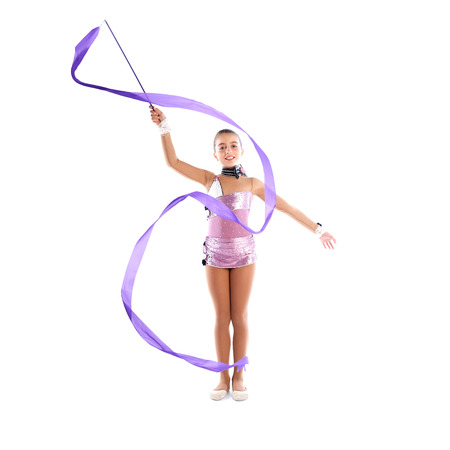 limber: Kid girl ribbon rhythmic gymnastics exercise on white  Stock Photo