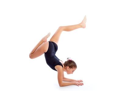 limber: Kid girl rhythmic gymnastics exercises on white background
