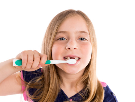 toothless: Blond kid indented girl cleaning teeth toothbrush on white