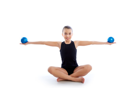 weighted: Fitness weighted Yoga Pilates balls kid girl exercise workout on white  Stock Photo