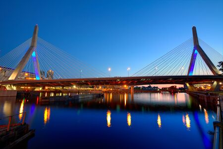 boston skyline: Boston Zakim bridge sunset in Bunker Hill Massachusetts USA Stock Photo