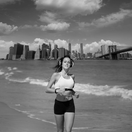 bridge footing: Brunette girl running in New York Brooklyn bridge photo mount Stock Photo