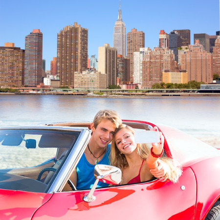 convertible car: selfie of young teen couple at convertible car in New York Manhattan skyline photo mount