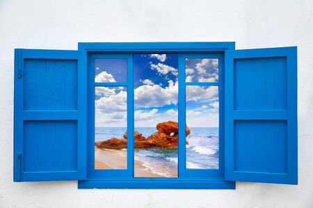 beach window: Almeria view from blue window of Mojacar beach photo mount Stock Photo