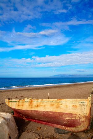 beached: Almeria Cabo de Gata beached boats in San Miguel beach of Spain